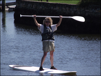 Woman doing stand up and paddle on Cape Cod.