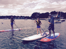 Group going paddleboarding.